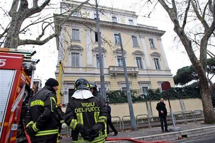 Firefighters stand outside the Greek Embassy in Rome, Monday, Dec. 27, 2010. (AP Photo/Andrew Medichini)