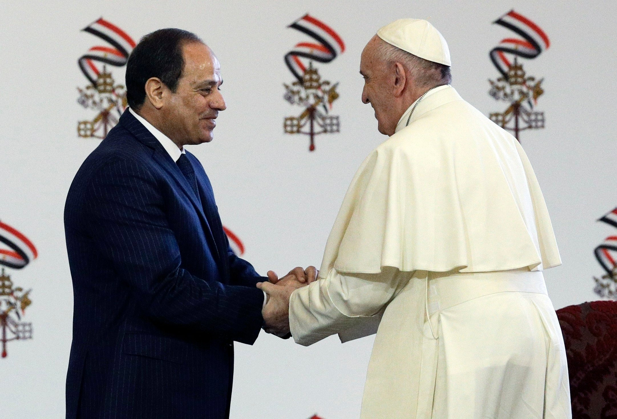 Pope Francis shakes hands with Egyptian President Abdel-Fattah El-Sissi, in Cairo, Friday, April 28, 2017. Francis is in Egypt for a two-day trip aimed at presenting a united Christian-Muslim front that repudiates violence committed in God's name. (AP Pho