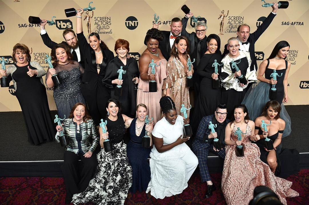 "The cast and crew of ""Orange is the New Black"" pose in the press room with the awards for the award for outstanding performance by an ensemble in a comedy series at the 23rd annual Screen Actors Guild Awards (Photo by Jordan Strauss/Invision/AP)"