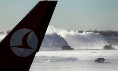 Snow removal continues at John F. Kennedy International Airport in New York, Monday, Dec. 27, 2010.