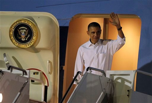 President Barack Obama arrives at Hickam Air Force base in Honolulu, Hawaii, Thursday, Dec. 23, 2010, for the his holiday vacation. (AP Photo/Chris Carlson)