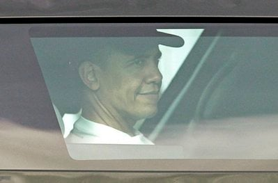 President Barack Obama travels by motorcade to his holiday vacation residence in Kailua, Hawaii, Monday, Dec. 27, 2010.