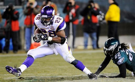 Minnesota Vikings running back Adrian Peterson (28) rushes past Philadelphia Eagles cornerback Asante Samuel (22) in the second half of an NFL football game, Tuesday, Dec. 28, 2010, in Philadelphia. Minnesota won 24-14. (AP Photo/Miles Kennedy)