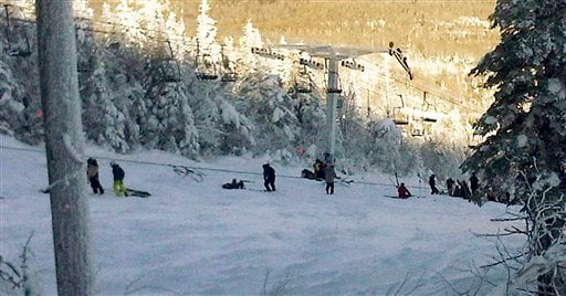 This photo provided by Al Noyes shows skiers and lift chairs on the slope after a lift derailed on the state's tallest mountain in Carrabassett Valley, Maine, Dec. 28, 2010. (AP Photo/Al Noyes)