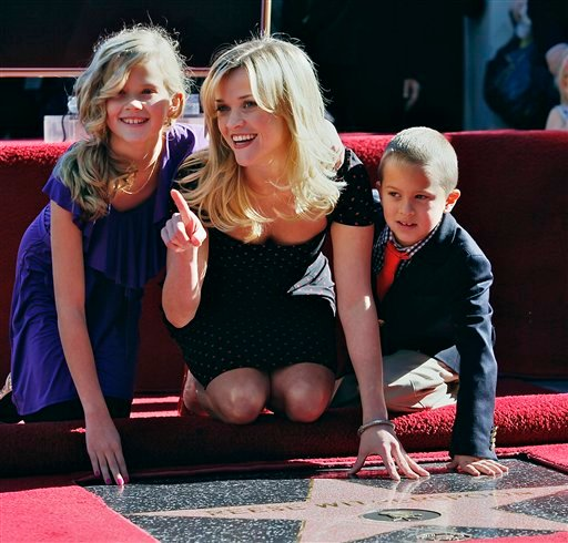 Academy Award winning actress Reese Witherspoon, are shown with her children Ava, left, and Deacon after being honored with a star on the Hollywood Walk of Fame on Wednesday, Dec. 1, 2010, in Los Angeles. (AP Photo/Damian Dovarganes)