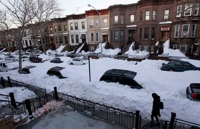 While most residents had cleared yards and sidewalks, many streets remained unplowed in the Sunset Park section of Brooklyn, N.Y., Tuesday, Dec. 28, 2010.