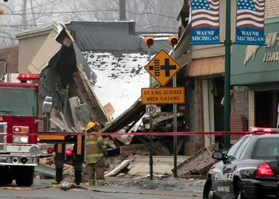 A firefighter surveys the damage after an apparent gas explosion at William C. Franks Furniture store on Wednesday, Dec. 29, 2010 in Wayne, Mich.