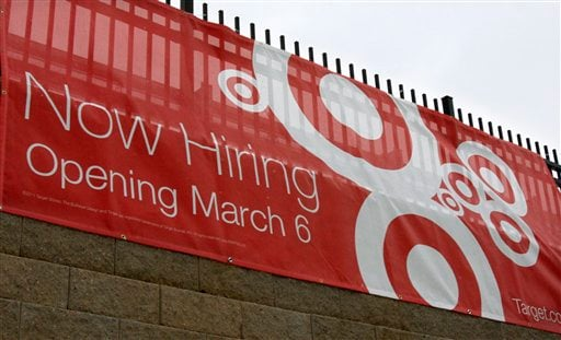 In this Dec. 26, 2010 photo, a sign advertises that a new Target store is hiring workers in Marborough, Mass. The number of people applying for unemployment benefits drops Thursday, De. 30, 2010, to lowest level since July 2008. (AP Photo/Bill Sikes)