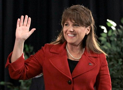 In this Nov. 2, 2010 file photo, Delaware Republican Senate candidate Christine O'Donnell waves before giving her concession speech to supporters in Dover, Del. (AP Photo/Rob Carr, file)