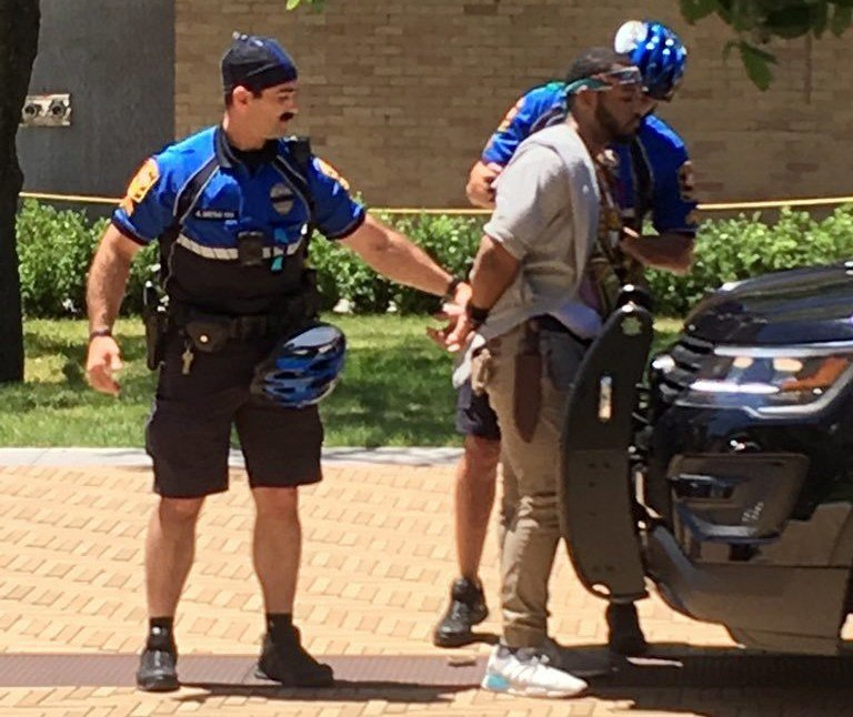 A man is arrested after a fatal stabbing attack on the University of Texas campus in Austin, Texas, Monday, May 1, 2017. (Ray Arredondo via AP)