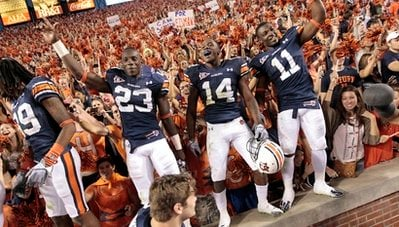 FILE - In this Saturday, Oct. 16, 2010 file photo, Auburn players Onterio McCalebb (23) Demond Washington (14) and Chris Davis (11) react after their 65-43 win over Arkansas in an NCAA college football game in Auburn, Ala.