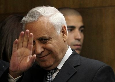 Former Israeli President Moshe Katsav gestures at the court in Tel Aviv, Thursday, Dec. 30, 2010.