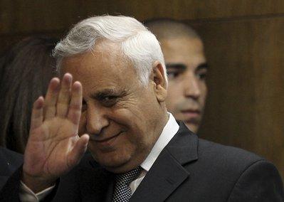 Former Israeli President Moshe Katsav gestures at the court in Tel Aviv, Thursday, Dec. 30, 2010.