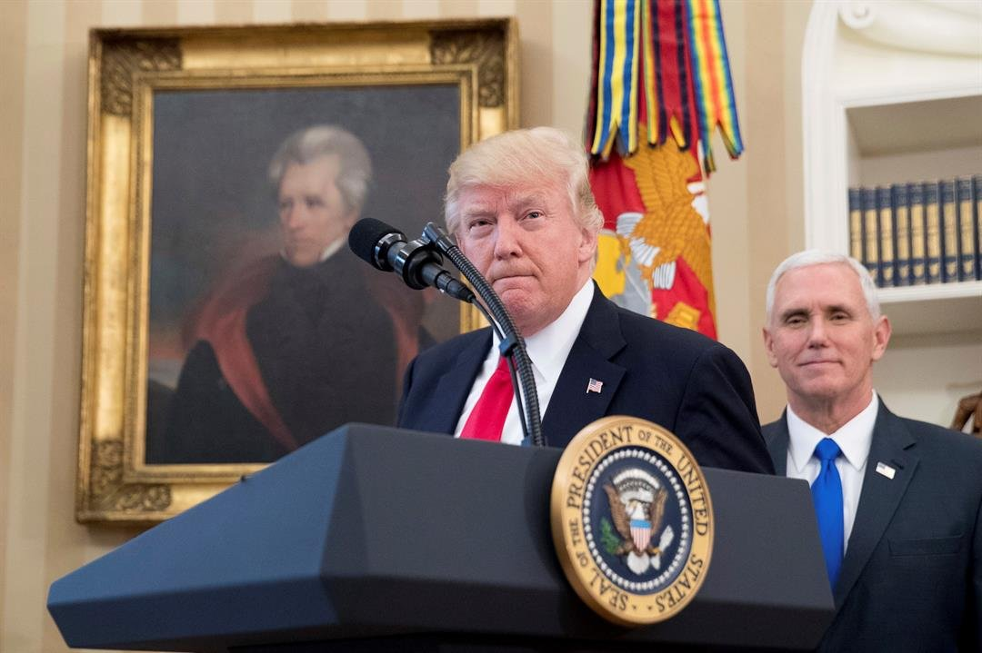 FILE - In this March 31, 2017 file photo, a portrait of former President Andrew Jackson hangs on the wall behind President Donald Trump, accompanied by Vice President Mike Pence, in the Oval Office at the White House in Washington. (AP Photo/Andrew Harnik
