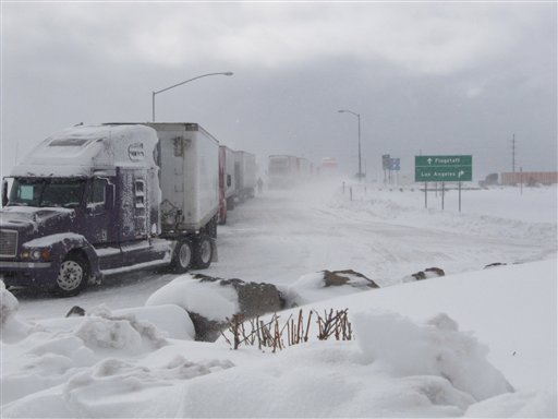 Semi-trucks line up over a bridge in Bellemont, Ariz., on Thursday, Dec. 30, 2010. A winter storm kept motorists off Interstate 40 in northern Arizona for hours. (AP Photo/Felicia Fonseca)