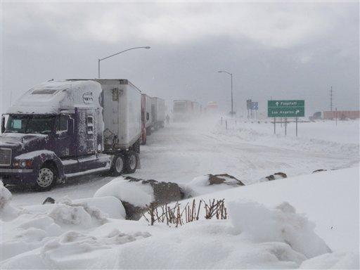 Semi-trucks line up over a bridge in Bellemont, Ariz., on Thursday, Dec. 30, 2010. A winter storm kept motorists off Interstate 40 in northern Arizona for hours. (AP Photo/Felicia Fonseca)