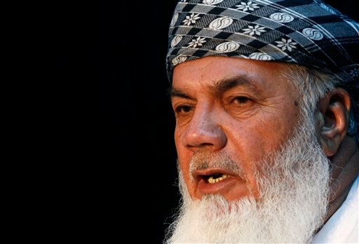 In this Sept. 27, 2009 file photo, Afghanistan's Energy Minister Ismail Khan speaks during a press conference in Kabul, Afghanistan. (AP Photo/Musadeq Sadeq, File)