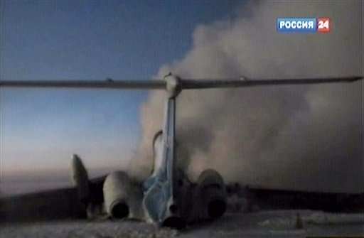 Image from Rossia 24 television channel TV: a tail part of the Russian passenger Tu-154 aircraft seen after an explosion in Surgut, about 2200 kilometers (1,350 miles) east of Moscow, Jan. 1, 2011. (AP Photo/Rossia 24 Television Channel)