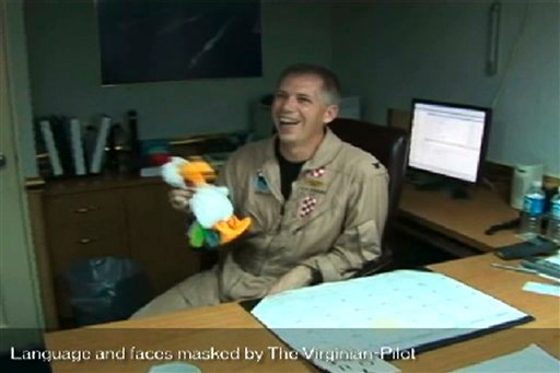 In this frame grab taken from video obtained by the Virginian-Pilot newspaper, U.S. Navy Capt. Owen Honors appears in one of a series of profanity-laced comedy sketches that were broadcast on the USS Enterprise via closed-circuit television.