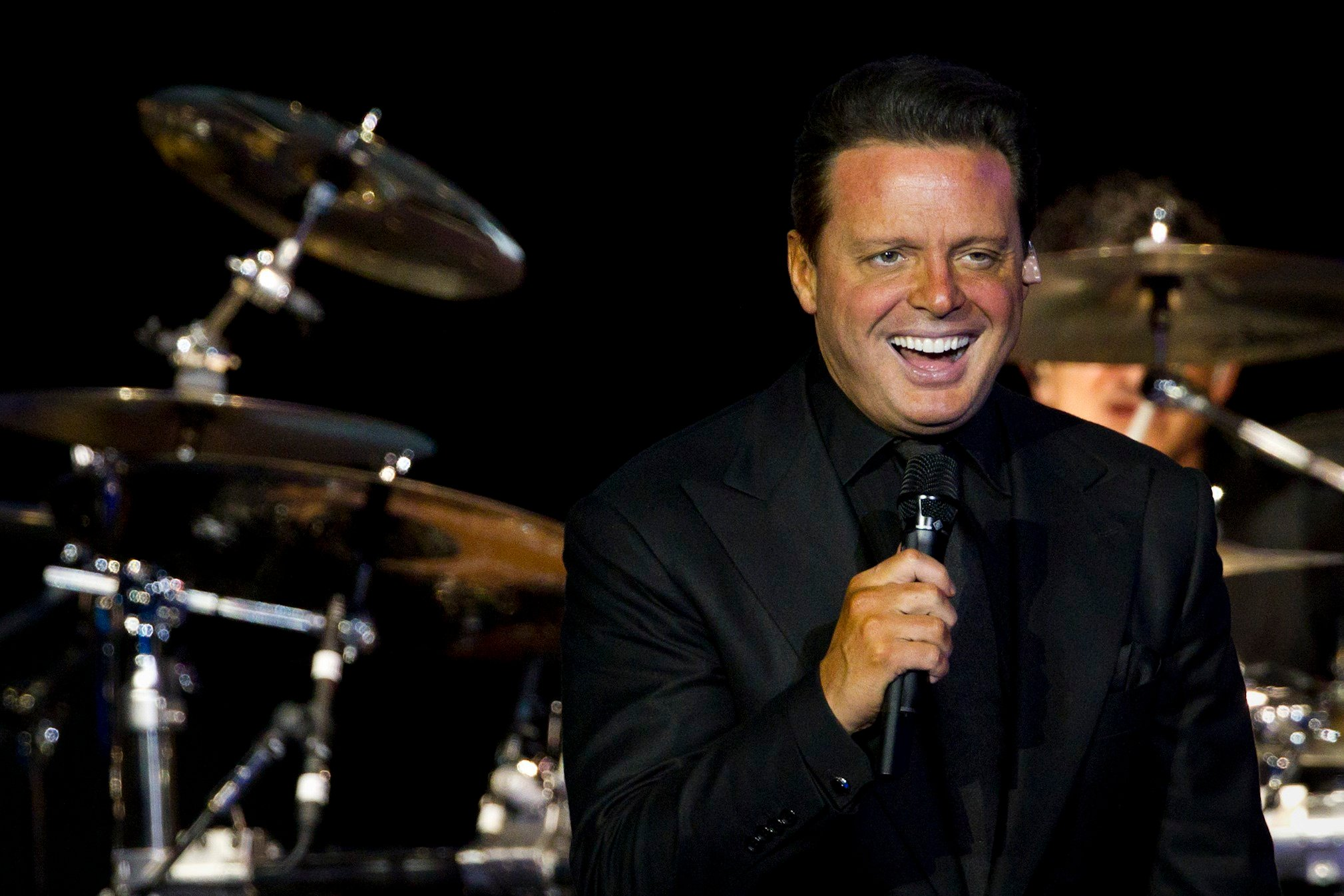 FILE - Mexican singer Luis Miguel performs during a concert in Rio de Janeiro, Brazil, Sunday March 11, 2012. (AP Photo/Felipe Dana)