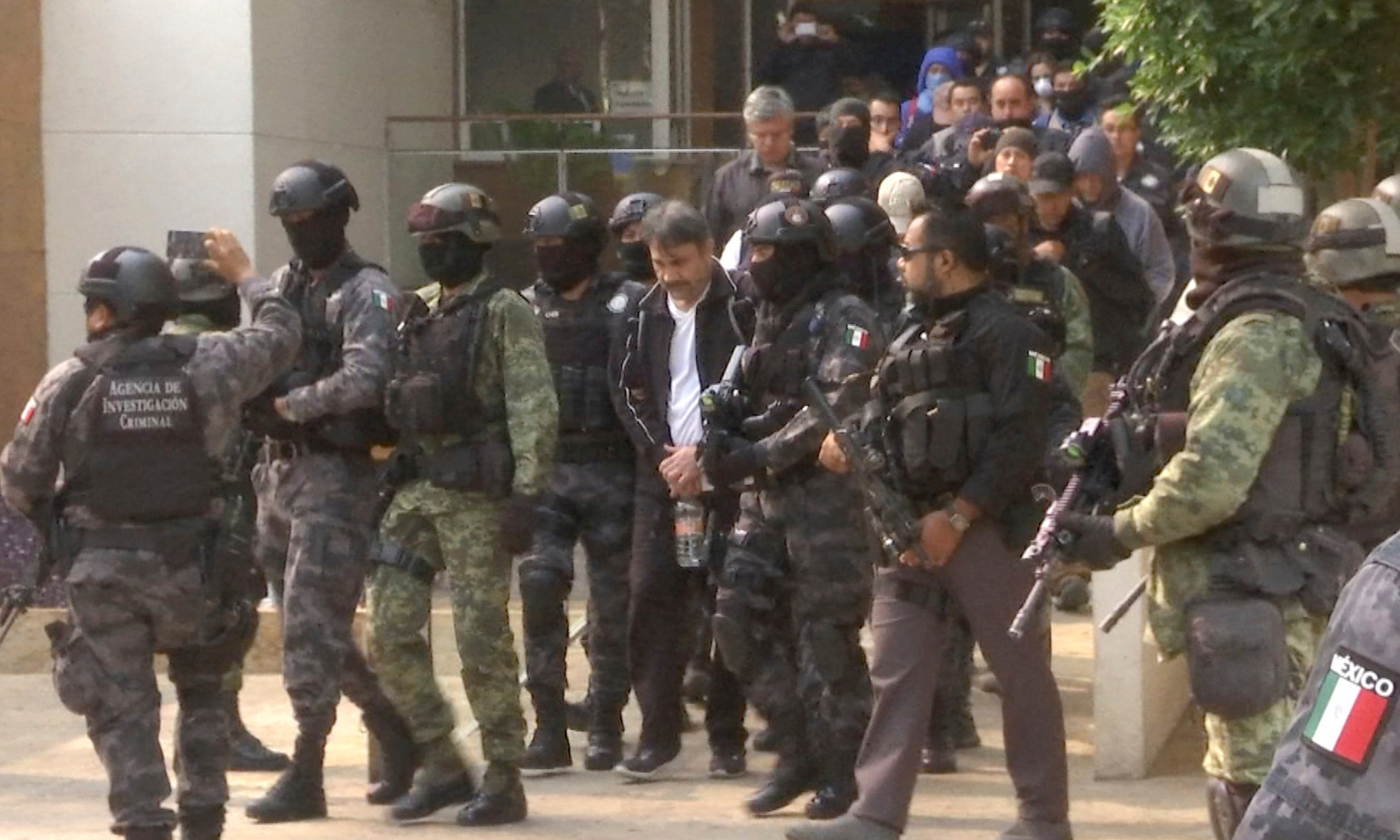 "This frame grab from video shows Damaso Lopez, known by the nickname ""El Licenciado,"" escorted by police after his capture at an upscale apartment building on a major boulevard in Mexico City, Tuesday, May 2, 2017.  (AP Photo/Jorge Barrera, APTN)"