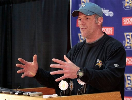 Minnesota Vikings quarterback Brett Favre addresses the media about the injury to his left shoulder during a news conference at the team's NFL football training facility in Eden Prairie, Minn. Wednesday, Dec. 8, 2010. (AP Photo/Andy King)