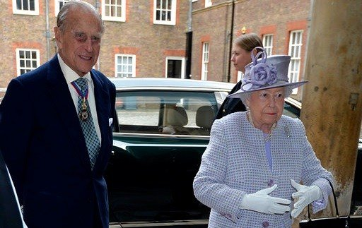 Britain's Queen Elizabeth, right, and Prince Philip, the Duke of Edinburgh arrive at Chapel Royal in St James's Palace, London