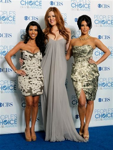 """From left, Kourtney Kardashian, Khloe Kardashian, and Kim Kardashian pose for a photo backstage with the award for favorite TV guilty pleasure for """"Keeping Up with the Kardashians"""" at the People's Choice Awards on Wednesday, Jan. 5, 2011, in Los Angeles."""
