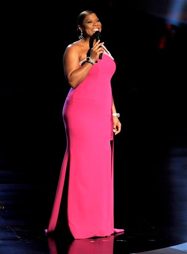 Host Queen Latifah is seen on stage at the People's Choice Awards on Wednesday, Jan. 5, 2011, in Los Angeles. (AP Photo/Chris Pizzello)