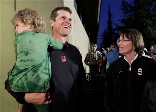 Stanford coach Jim Harbaugh arrives at the Stanford University campus with his daughter, Addison, as Stanford women's basketball coach Tara VanDerveer, right, looks on in Stanford, Calif., Tuesday, Jan. 4, 2011. (AP Photo/Paul Sakuma)