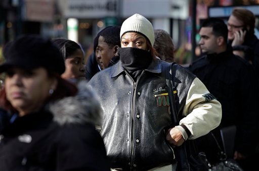 In this Dec. 8, 2010 photo, Angela Harrington waits in line to attend a job fair, in New York. Slightly fewer people applied for unemployment benefits last week, the second drop in three weeks. (AP Photo/Mark Lennihan)