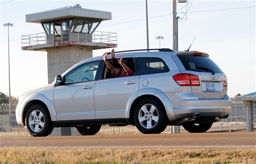 Gladys and Jamie Scott wave from a vehicle as they leave the Central Mississippi Correctional Facility in Pearl, Miss., Friday, Jan. 7, 2011.