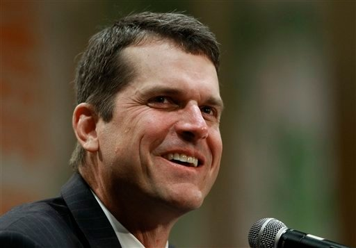 In this Jan. 2, 2011, file photo, Stanford football head coach Jim Harbaugh answers questions during a coach's new conference in Ft. Lauderdale, Fla. Harbaugh is to meet Miami Dolphins officials in the San Francisco area on Thursday. (AP Photo/Hans Deryk)