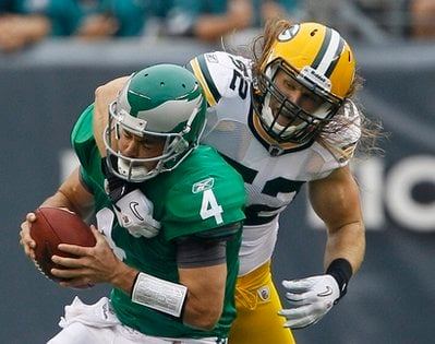 FILE - In this file photo taken Sept. 12, 2010, Philadelphia Eagles quarterback Kevin Kolb, left, is sacked by Green Bay Packers linebacker Clay Matthews in the first half of an NFL football game in Philadelphia.