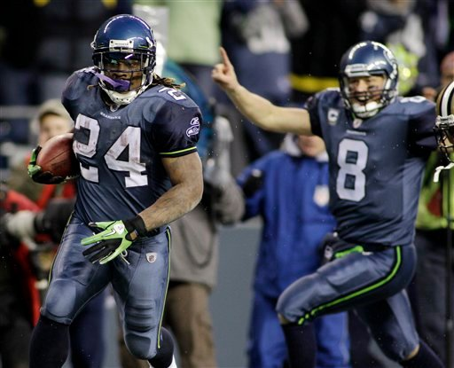 Seattle Seahawks' Marshawn Lynch (24) breaks away to score a touchdown as quarterback Matt Hasselbeck celebrates in the background during the second half of an NFL NFC wild card playoff football game, Saturday, Jan. 8, 2011.