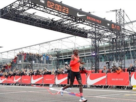 Olympic marathon champion Eliud Kipchoge crosses the finish line of a marathon race at the Monza Formula One racetrack, Italy.