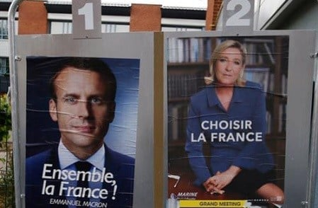 Election campaign posters for French centrist presidential candidate Emmanuel Macron and far-right candidate Marine Le Pen.