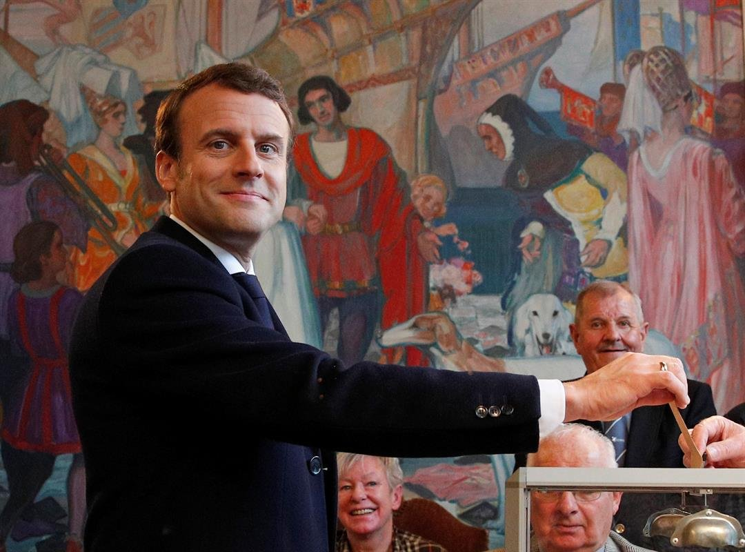 French independent centrist presidential candidate Emmanuel Macron casts his ballot in the presidential runoff election in Le Touquet, France, Sunday, May 7, 2017. (AP Photo/Christophe Ena, POOL)