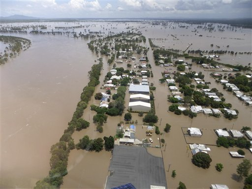 In this image provided by the Rockhampton Regional Council, water inundates the suburb of Depot Hill at Rockhampton, Australia, Tuesday, Jan. 4, 2011.