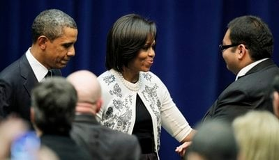 President Barack Obama and first lady Michelle Obama greet Daniel Hernandez, a intern for Rep. Gabrielle Giffords at a memorial service for the victims of Saturday's shootings at McKale Center on the University of Arizona campus Wednesday, Jan. 12, 2011,