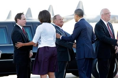 President Barack Obama shakes hands with Sheriff Clarence Dupnik as he and first lady Michelle Obama arrive in Tucson, Ariz., to attend a memorial service for victims of last Saturday's shooting rampage that killed six people and left 14 injured.