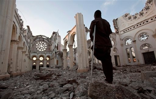 Icaris Celnet stands in the ruins of The Cathedral of Our Lady of the Assumption, often called Cathédrale de Port-au-Prince, Jan. 11, 2011 in Port-au-Prince, Haiti. (AP Photo/The Canadian Press, Paul Chiasson)