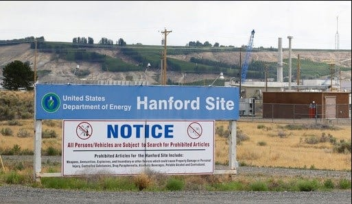 In this July 9, 2014 file photo, a sign informs visitors of prohibited items on the Hanford Nuclear Reservation near Richland, Wash.