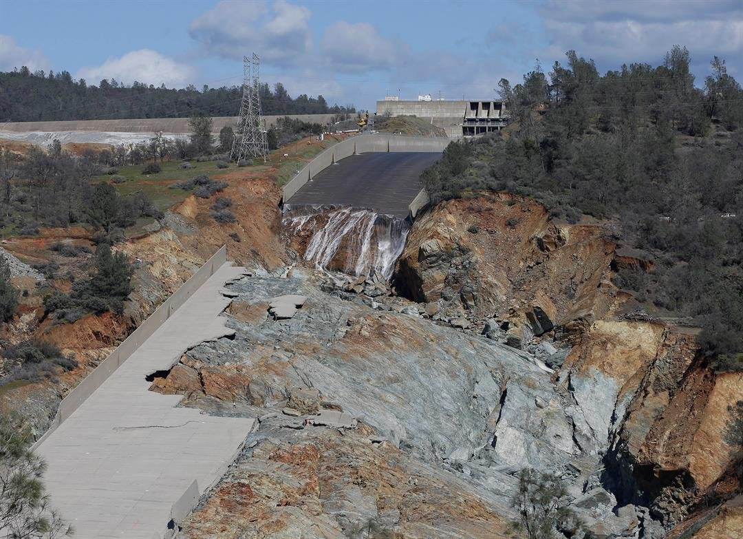 In this February file photo, a small flow of water goes down Oroville Dam's crippled spillway in Oroville, Calif. (AP Photo/Rich Pedroncelli, File)
