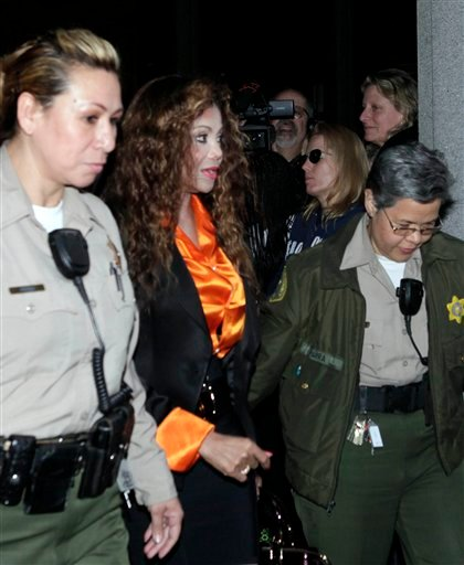 Michael Jackson's sister LaToya Jackson, center is escorted from court after a hearing for Jackson's doctor, Conrad Murray Tuesday Jan. 11, 2011 iin Los Angeles.