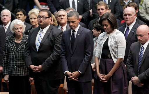President Barack Obama and first lady Michelle Obama attend memorial service for the victims of Saturday's shootings, at McKale Center on the University of Arizona campus Jan. 12, 2011, in Tucson, Ariz. (AP Photo/J. Scott Applewhite)