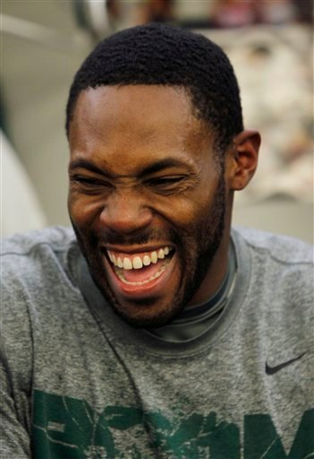 New York Jets cornerback Antonio Cromartie laughs as he sits at his locker after practice Friday, Jan. 14, 2011, in Florham Park, N.J. (AP Photo/Mel Evans)