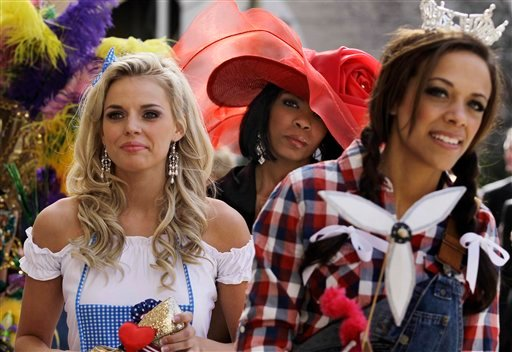 "Miss America contestants, from left, Lauren Werhan, Miss Kansas, Djuan Keila, Miss Kentucky and Pauli Mayfield, Miss Iowa, line up to appear on stage during the ""Show Us Your Shoes"" parade, Friday, Jan. 14, 2011 in Las Vegas. (AP Photo/Julie Jacobson)"