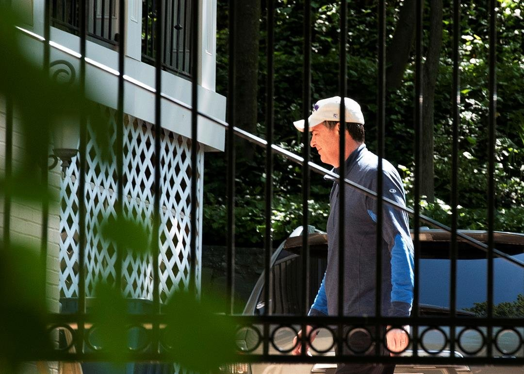 Former FBI Director James Comey walks at his home in McLean, Va., Wednesday, May 10, 2017. (AP Photo/Sait Serkan Gurbuz)