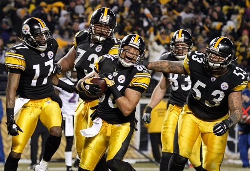 Pittsburgh Steelers wide receiver Hines Ward (86) celebrates with teammates after scoring a touchdown against the Baltimore Ravens during the second half of an NFL divisional football game in Pittsburgh, Saturday, Jan. 15, 2011. (AP)